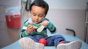 In this April 2019 photo provided by the St. Jude Children's Research Hospital, 2-year-old Gael Jesus Pino Alva plays with toys at the hospital in Memphis. (Peter Barta/St. Jude Children's Research Hospital via AP)