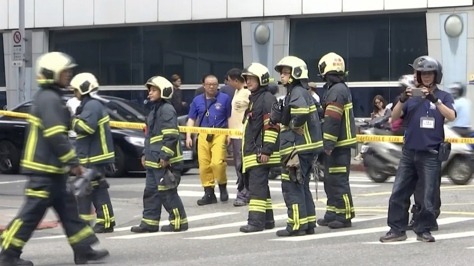 In this image made from a video, firefighters gather on a street in Taipei, Taiwan following an earthquake Thursday, April 18, 2019. A strong earthquake struck Taiwan's east coast Thursday afternoon, according to the island's Central Weather Bureau. (AP Photo)