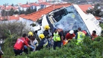 Rescue officials attend the scene after a tour bus crashed in Canico on Portugal's Madeira Island, Wednesday, April 17, 2019. (Rui Silva/Aspress/Global Imagens via AP)