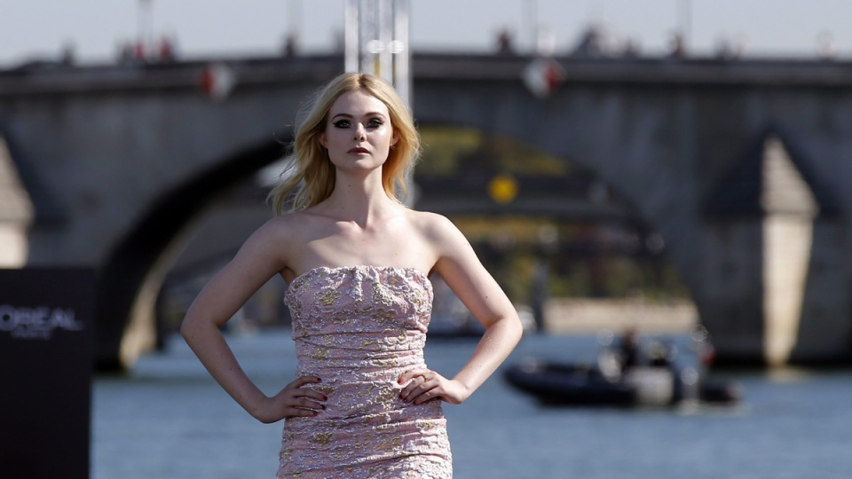 Elle Fanning models in Paris, on Sept.30, 2018. (Michel Euler / AP)