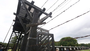 In this July 18, 2017 photo the wooden main gate leads into the former Nazi German Stutthof concentration camp in Sztutowo, Poland. (AP Photo/Czarek Sokolowski)