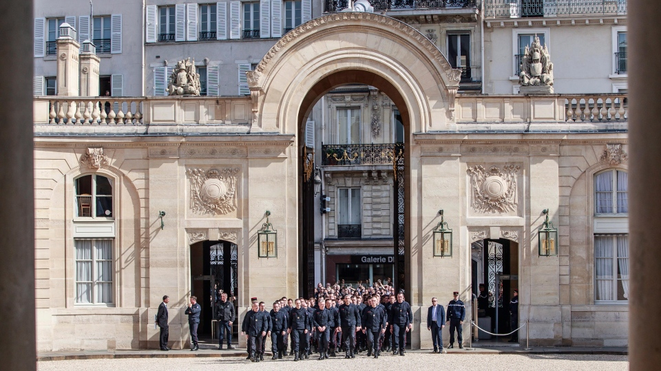 Firefighters and security forces who took part to the fire extinguishing operations at Notre Dame of Paris Cathedral, arrive for a ceremony at the Elysee Palace in Paris, Thursday, April 18, 2019. France paid a daylong tribute Thursday to the Paris firefighters who saved the internationally revered Notre Dame Cathedral from collapse and rescued many of its treasures.(Christophe Petit Tesson, Pool via AP)