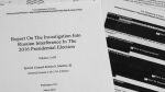 Special counsel Robert Mueller's redacted report on Russian interference in the 2016 presidential election as released on Thursday, April 18, 2019. (Jon Elswick / AP)