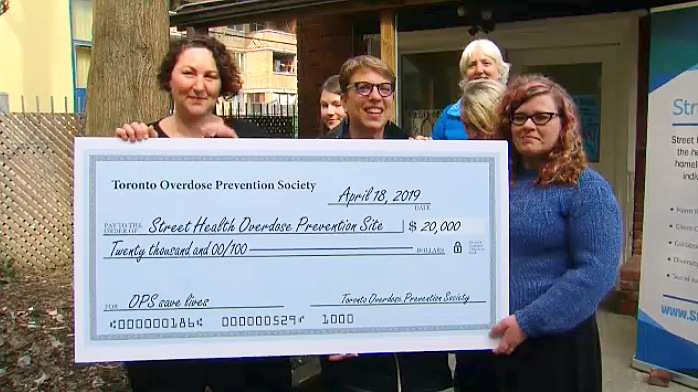 Street Health Community Nursing receives $20,000 from community donations gathered by the Toronto Overdose Prevention Society on April 18, 2019.