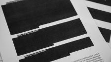 Special counsel Robert Mueller's report, with redactions, as released on April 18, 2019. (Jon Elswick / AP)