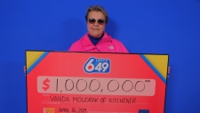 Vanda Moudrak poses with her $1 million cheque. (Source: OLG)
