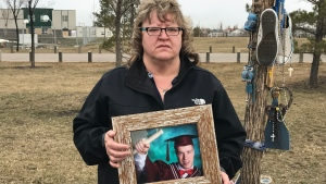 Kim Krupa with photo of son Tanner