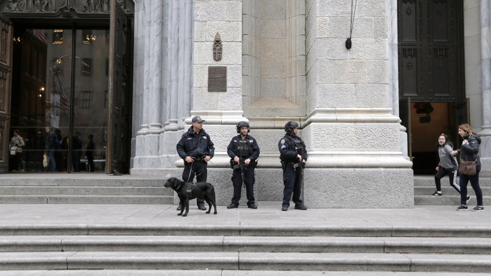 A larger-than-usual security presence is seen at St. Patrick's Cathedral in New York, Thursday, April 18, 2019. (AP Photo/Seth Wenig)