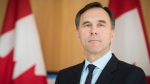 Bill Morneau, Minister of Finance, listens to questions asked by the media during a press conference on the national pharmacare program at the Li Ka Shing Knowledge Institute in Toronto on Wednesday, March 6, 2019. THE CANADIAN PRESS/ Tijana Martin