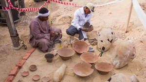 Egyptian excavation workers restore pottery near a new found in a tomb in Draa Abul Naga necropolis on Luxor's West Bank in this file photo. (AP Photo/Hamada Elrasam)