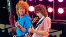 In this July 13, 1985 file photo, Led Zeppelin bandmates, singer Robert Plant (left) and guitarist Jimmy Page, reunite to perform for the Live Aid famine relief concert at JFK Stadium in Philadelphia. Plant and his band, The Sensational Space Shifters, will perform in September at the Harvest Jazz and Blues Festival in Fredericton, N.B. (AP Photo/Amy Sancetta, File)