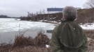 Todd Thomas watches ice hut on Kelly Lake in Sudbury as ice begins to melt. (Ian Campbell/CTV Northern Ontario)