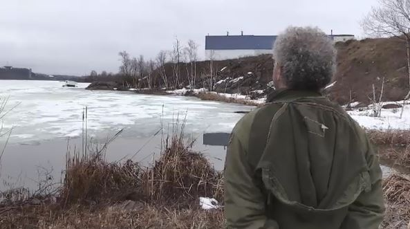 Todd Thomas watches ice hut on Kelly Lake