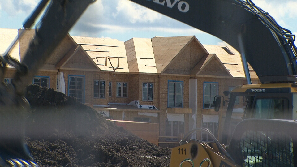 A construction crew works on a new home.