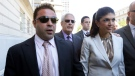 "In this July 30, 2013 file photo, ""The Real Housewives of New Jersey"" stars Giuseppe ""Joe"" Giudice, 43, left, and his wife, Teresa Giudice, 41, of Montville Township, N.J., walk out of Martin Luther King, Jr. Courthouse after an appearance in Newark, N.J. (AP Photo/Julio Cortez, File)"