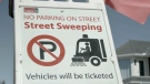 City of Calgary street sweeping parking ban sign