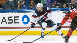In this Nov. 12, 2017, file photo, United States' Hilary Knight (21) controls the puck in front of Canada's Meaghan Mikkelson, right, during the second period of the Four Nations Cup championship hockey game in Tampa, Fla. (AP Photo/Willie J. Allen Jr., File)