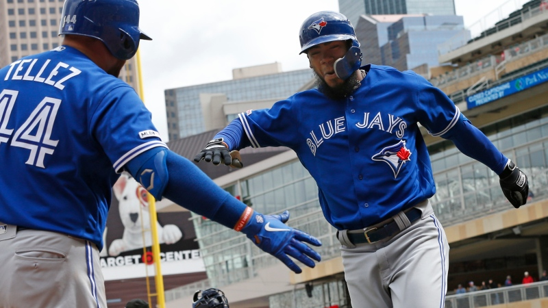 Toronto Blue Jays' Teoscar Hernandez, right, and Rowdy Tellez celebrate Hernandez's solo home run off Minnesota Twins pitcher Tyler Duffey in the eighth inning of a baseball game Thursday, April 18, 2019, in Minneapolis. The Blue Jays won 7-4. (AP Photo/Jim Mone)