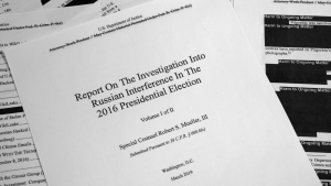 Special counsel Robert Mueller's redacted report on Russian interference in the 2016 presidential election as released on Thursday, April 18, 2019, is photographed in Washington. (AP / Jon Elswick)