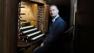 Johann Vexo, the organist who was playing at evening mass inside Notre Dame when flames began licking at the iconic cathedral's roof, poses at the pipe organ at Notre Dame de Nancy cathedral, eastern France, Wednesday, April 17, 2019. Vexo , who was playing at evening mass inside Notre Dame when flames began licking at the iconic cathedral's roof says people didn't immediately react when the fire alarm rang as a priest was reading from the Bible. (AP / Oleg Cetinic)