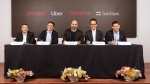 In this Thursday, April 18, 2019, photo provided by Toyota Motor Corporation, from left, Denso Corp. Executive Vice President Hiroyuki Wakabayashi, Head of Uber ATG Eric Meyhofer, CEO of Uber Technologies, Inc. Dara Khosrowshahi, Toyota Executive Vice President Shigeki Tomoyama and Managing Partner of Softbank Vision Fund Ervin Tu attend a press conference at Uber headquarters in San Francisco. (Toyota Motor Corporation via AP)