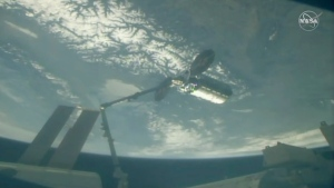 In this image taken from NASA Television, Cygnus capsule arrives at the International Space Station with food galore, following a 1 1/2-day journey from Virginia, Friday, April 19, 2019. (NASA TV via AP)