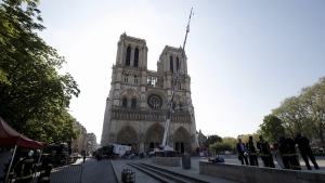 A crane works at Notre-Dame cathedral in Paris, Friday, April 19, 2019. (Philippe Wojazer / Pool via AP)