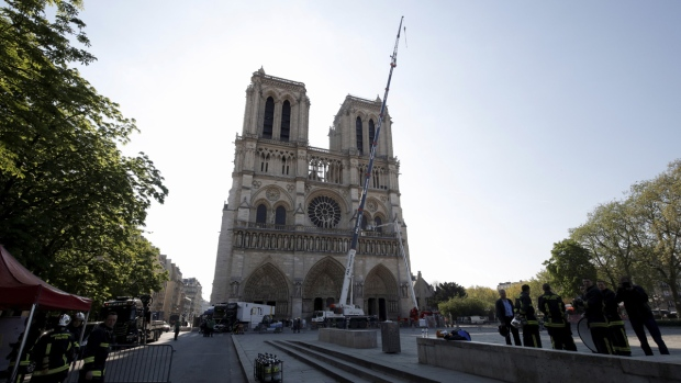 A crane works at Notre-Dame cathedral