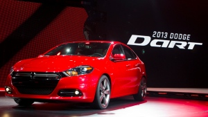 In this Monday, Jan. 9, 2012, file photo, the 2013 Dodge Dart is unveiled at the North American International Auto Show, in Detroit, Mich.