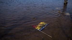 A year after record spring flooding in New Brunswick, officials say only Mother Nature knows if there will be a repeat this year. A New Brunswick flag floats in floodwater from the Saint John River in Waterborough, N.B., on Sunday, May 13, 2018. THE CANADIAN PRESS/Darren Calabrese