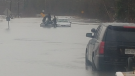 Huntsville OPP use a boat to rescue a couple from their vehicle on April 19, 2019. (Photo Credit: OPP)