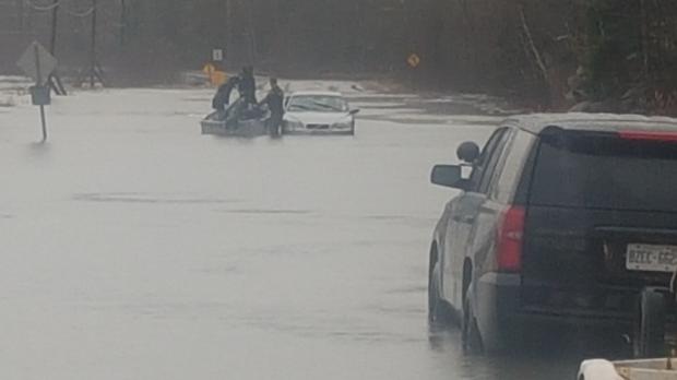 Huntsville OPP rescue car from flooding