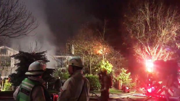 Crews respond to a three-alarm fire that damaged two neighbouring homes in Burnaby on Friday, April 19, 2019.