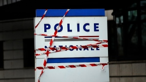 In this Dec. 19, 2018 file photo, stickers are set up in protest on the entrance of the police station in Mantes-la-Jolie, west of Paris. (AP Photo/Christophe Ena, File)