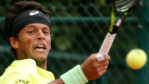File photo: Brazil's Joao Souza returns in the first round match of the French Open tennis tournament against Spain's Daniel Gimeno-Traver at the Roland Garros stadium, in Paris, France. Tuesday, May 26, 2015. (AP Photo/Christophe Ena, File)
