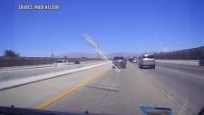 Flying ladder smashes into windshield