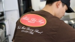 """This Tuesday, April 16, 2019, photo shows Ryne Aniya preparing food before the lunch rush at Aloha Poke Shop, a store in Honolulu that received a letter from Chicago-based Aloha Poke Co. saying the Illinois company had trademarked """"Aloha Poke"""" and the Hawaii company would need to change its name. (AP Photo/Audrey McAvoy)"""