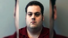 This booking photo released Thursday, March 1, 2018, by the Beverly Police Department shows Daniel Frisiello, of Beverly, Mass., accused of mailing five envelopes containing a white powder. (Beverly Police Department via AP, File)