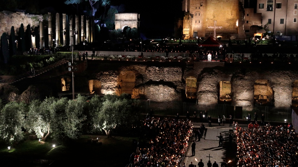 Pope Francis presides over the Via Crucis (Way of the Cross) torchlight procession in front of Rome's Colosseum on Good Friday, a Christian holiday commemorating the crucifixion of Jesus Christ and his death at Calvary, in Rome, Friday, April 19, 2019. (AP Photo/Gregorio Borgia)