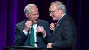 Green Leader Peter Bevan-Baker, left, and Liberal Leader Wade MacLauchlan chat at the end of the provincial leaders debate at the Harbourfront Theatre in Summerside, P.E.I. on Tuesday, April 16, 2019. THE CANADIAN PRESS/Andrew Vaughan