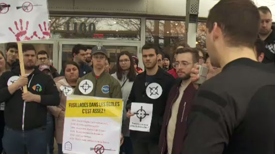 Students protest outside Prime Minister Justin Trudeau's riding office in Montreal to call for stricter gun control laws on Fri., April 19, 2019.