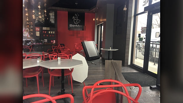 CTV Winnipeg captured photographs of tables toppled over and graffiti on the wall inside the restaurant. (Source: Beth Macdonell/CTV Winnipeg)