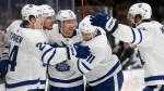 Toronto Maple Leafs' Auston Matthews (34) celebrates his goal with teammates during the third period in Game 5 of an NHL hockey first-round playoff series against the Boston Bruins in Boston, Friday, April 19, 2019. (AP Photo/Michael Dwyer)