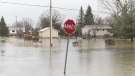 A residential street is shown surrounded by floodwaters in the town of Rigaud, Que. west of Montreal, Friday, April 19, 2019. THE CANADIAN PRESS/Graham Hughes