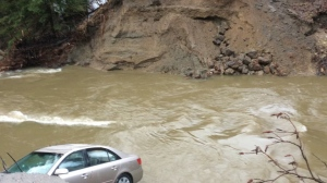 One person is dead after a road in Pontiac, Que. was washed out by flood waters. (Police_MRC/ Twitter)
