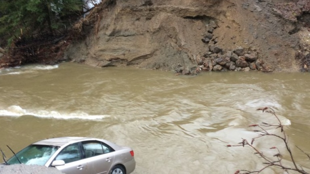 Woman dead after flood waters in Quebec sweep away road
