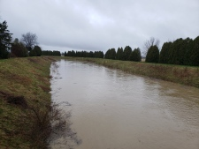 A LTVCA employee says the diversion channel is running, keeping McGregor Creek's water out of south Chatham's subdivisions on Saturday, April 20, 2019.