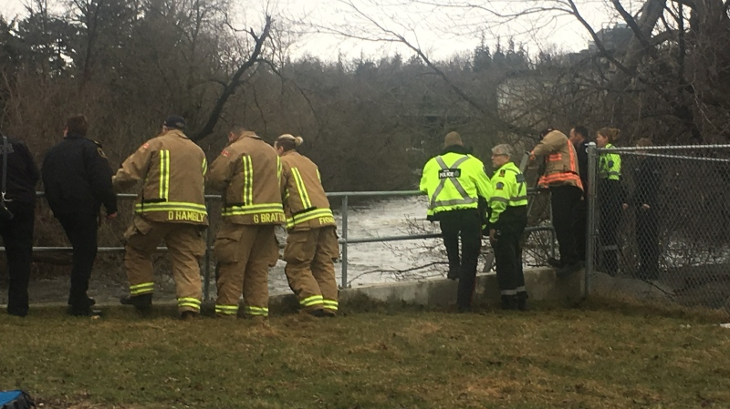 First responders gather at the side of the Speed River in Guelph as a water rescue is performed.