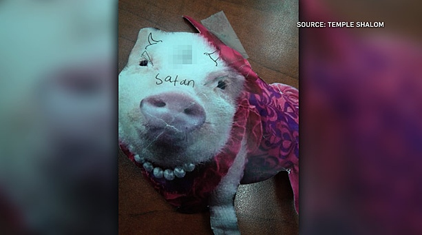 At nearby Temple Shalom on Grant Avenue a poster showing the image of a pig with a swastika was posted on the building last week. (Source: Temple Shalom)