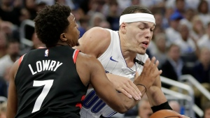 Orlando Magic's Aaron Gordon, right, struggles to get around Toronto Raptors' Kyle Lowry (7) during the second half in Game 3 of a first-round NBA basketball playoff series, Friday, April 19, 2019, in Orlando, Fla. (AP Photo/John Raoux)